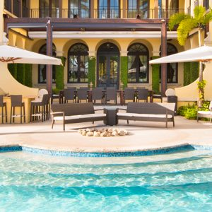 An exclusive Spanish Colonial style villa with an enormous pool area.